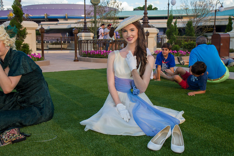 A woman poses on the Disney grass during Dapper Day