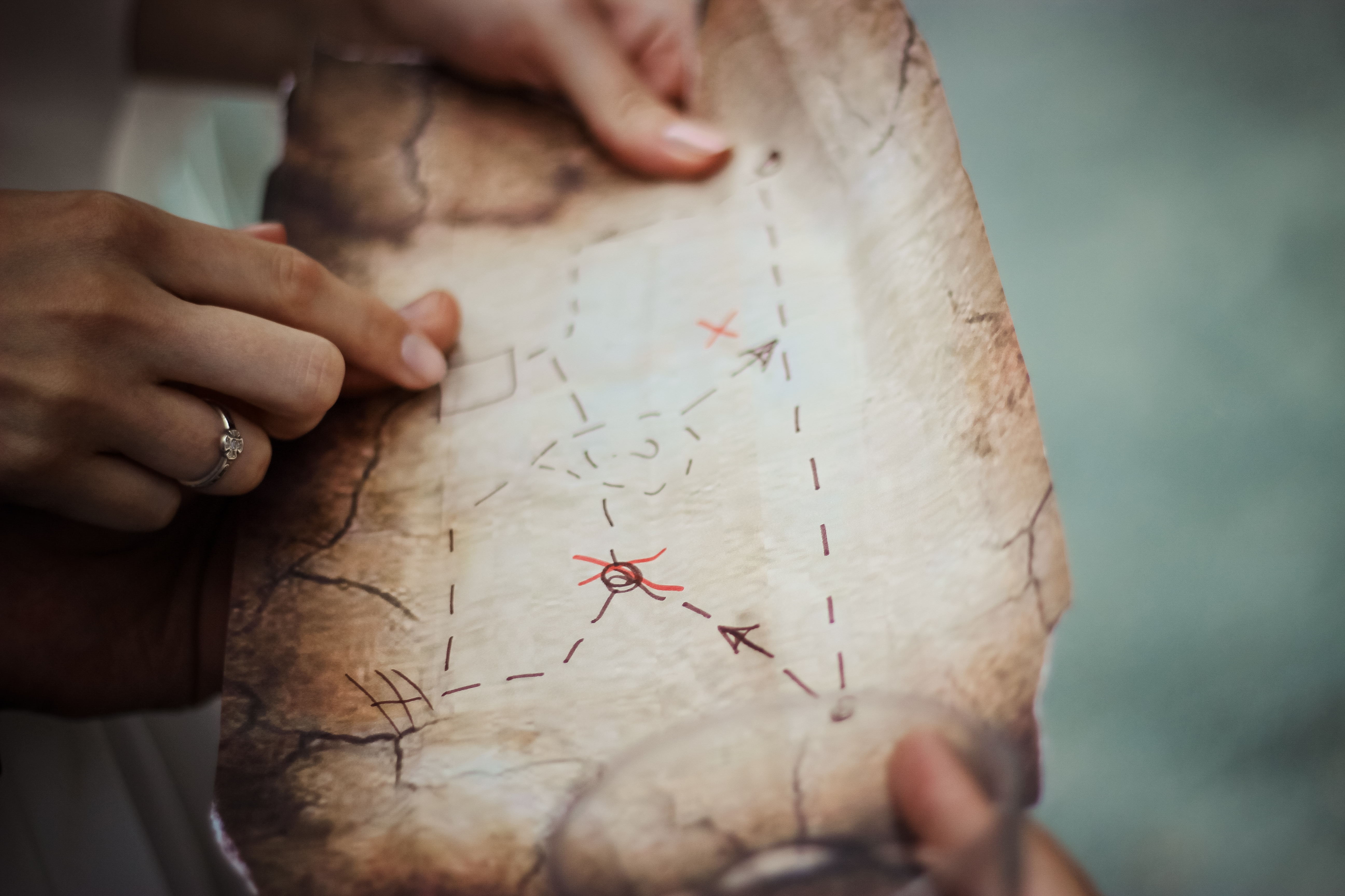 Person holding a brown treasure map