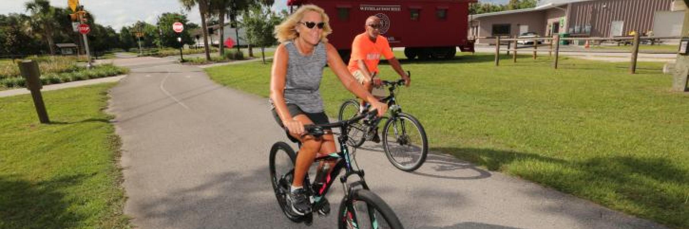 Man and woman biking through Withlacoochee State Trail