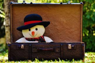 Snowman in an open suitcase