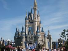 Cinderella castle at Walt Disney World with crowds of people